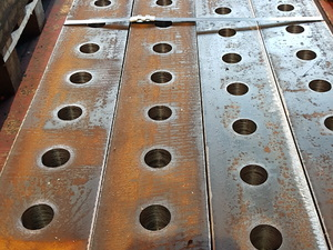 Drilled steel rails