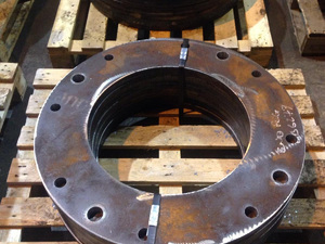 Profiled flanges with multiple diameter drilled holes.