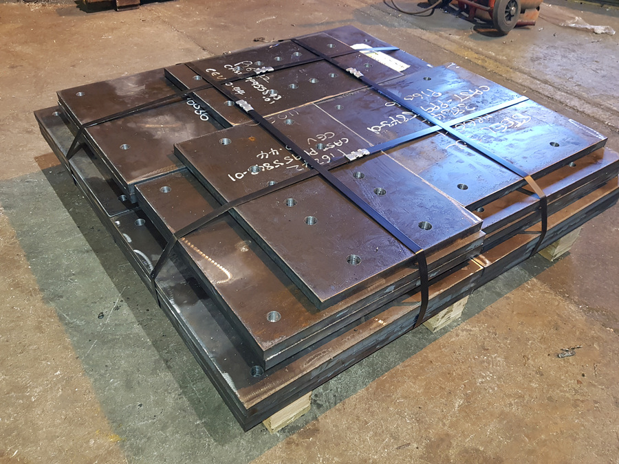 Drilled steel base plates